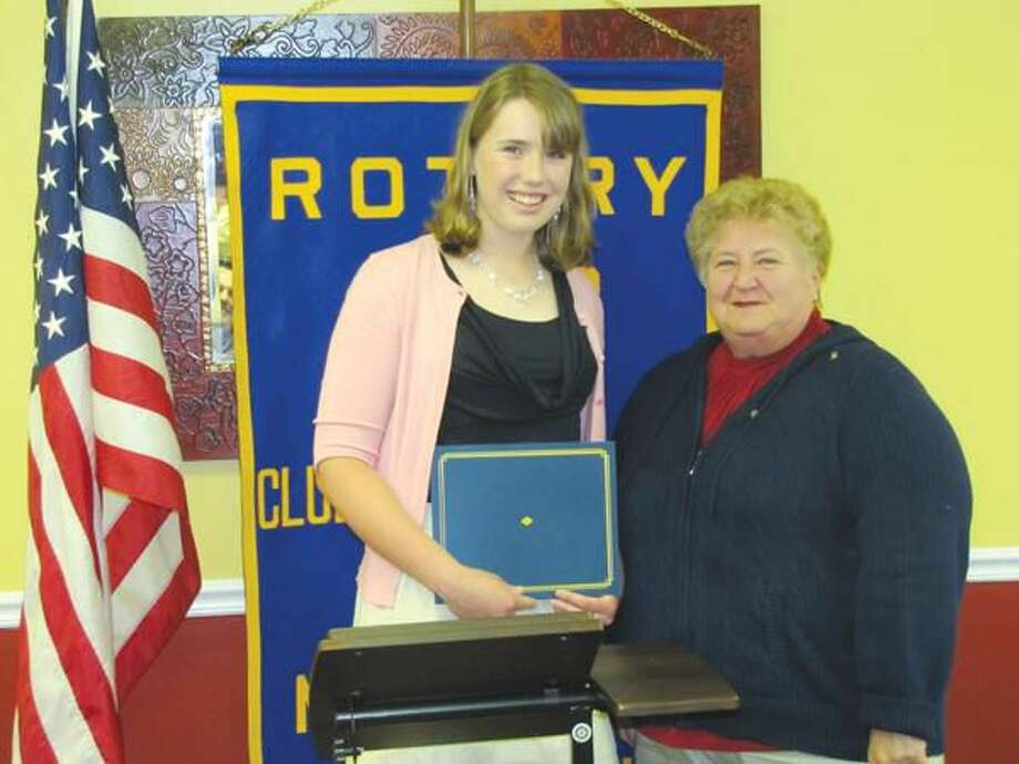 Photo courtesy of David Marchesseault, Rotary Secretary Emily Caroll receves her Student of the Month certificate for May from Program Chairperson, Mary Jane Mulligan.