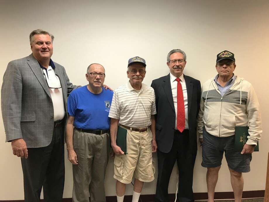 From left, Mark Halliday, Assisted Living Services/Assisted Living Technologies Community Liaison; veterans Bob Boucher and Roberto Gagliardi of Wallingford; Attorney Henry Weatherby, and veteran Bob Fortino of North Branford, at the monthly Veterans Coffee House at the Wallingford Senior Center in August. The next gathering is scheduled for Jan. 23.