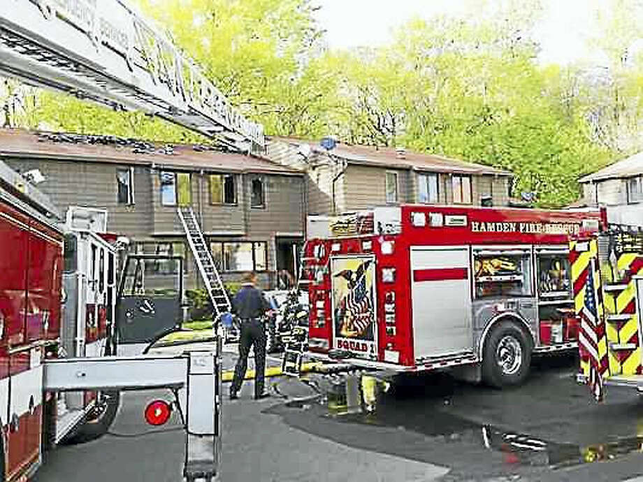 Kathleen Schassler — New Haven Register Hamden firefighters responded to a multi-unit condo fire at Hillside Village housing complex on Townsend Road Wednesday.