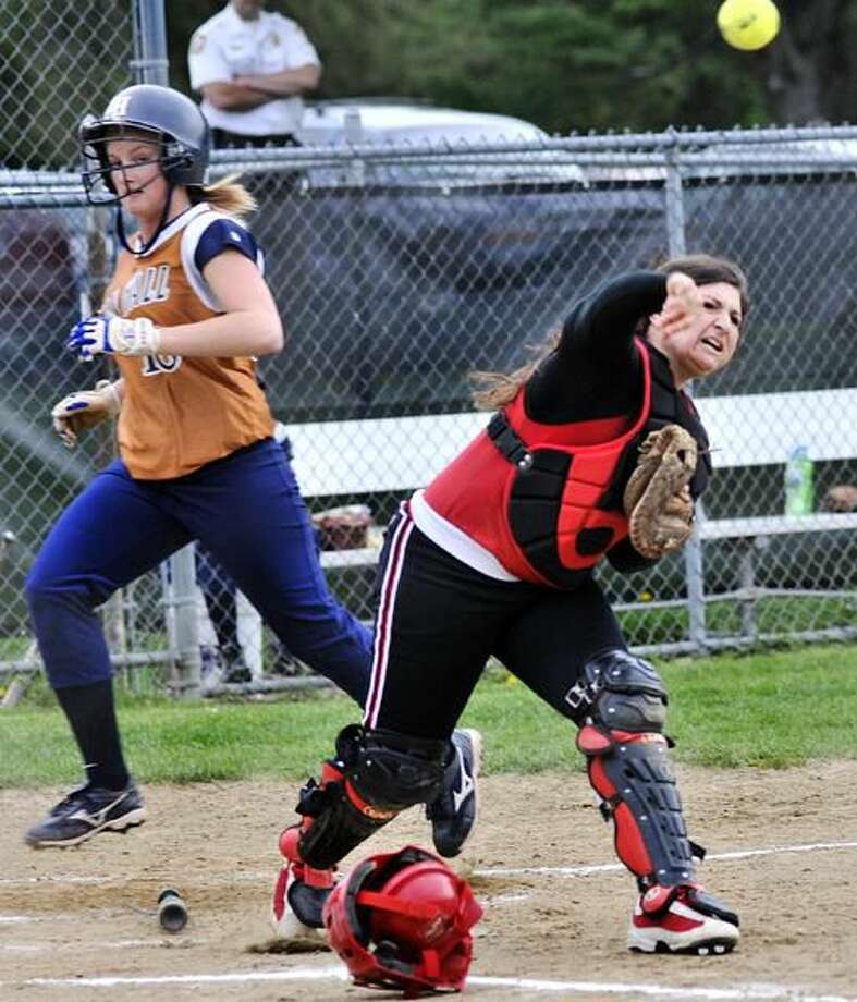 Photo by Melanie Stengel/Register Cheshire's Anna Marcucilli forces Lyman Hall's Christine Andrulat at the plate and fires a double play throw to first base. The play ended a bases-loaded threat and the sixth inning.