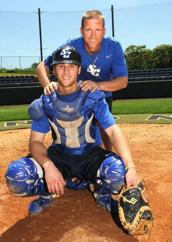 Photo by Melanie Stengel/Register SCSU catcher T.J. Shea (front) and his father, coach, Tim Shea.