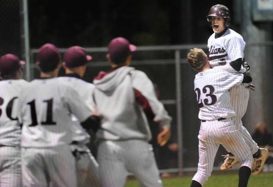 Photo by Melanie Stengel/Register North Haven baseball players celebrate their 6-5 win over Xavier in 12 innings Monday night in North Haven.