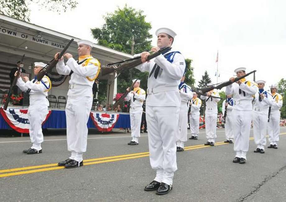 Photo by Brad Horrigan The Groton Naval Submarine School's Silver Dolphins Drill Team performs at Saturday's North Haven Memorial Day Parade.