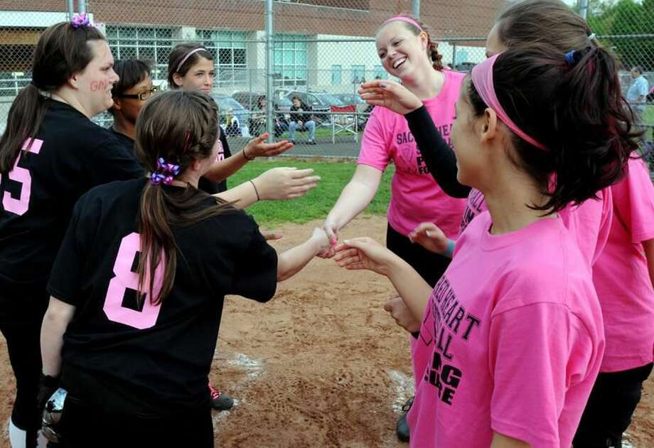 Photo by Mara Lavitt/Register Players from Hamden and Sacred Heart Academy greet each other before the start of the game.