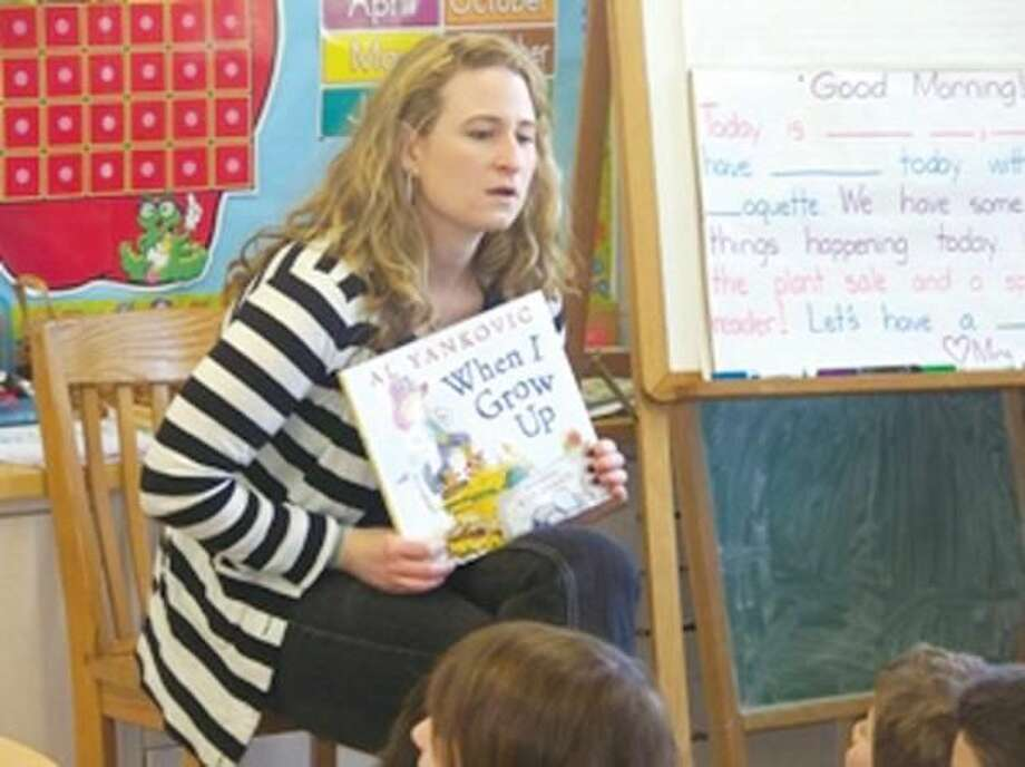 Submitted Photo Reader Susan Rascati of Rascati Financial, North Haven, participates in Quinnipiac Chamber's 13th annual Read Aloud Day.