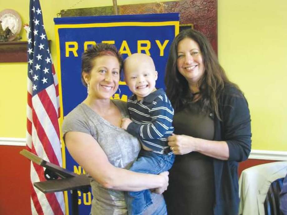 Photos courtesy of David Marchesseault, Rotary Secretary Past President of the North Haven Rotary Club, Theresa Viele, right, introduced Robin Raiano and her son, Logan, to the club last Tuesday at the Breakfast Nook Restaurant in North Haven.