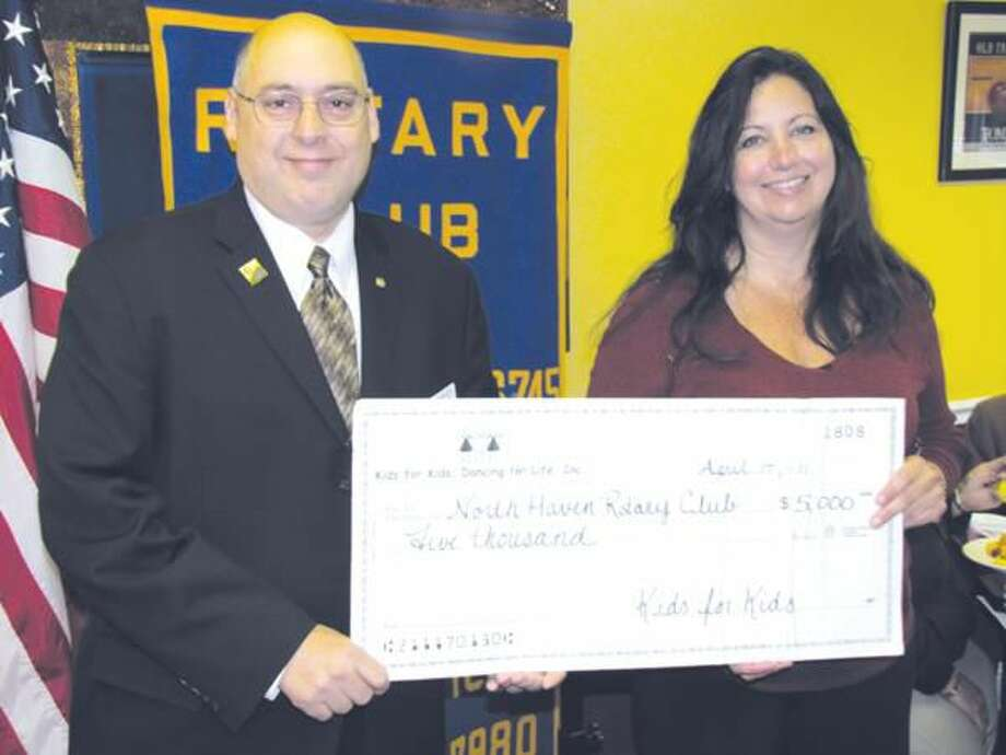 Photo courtesy of David Marchesseault, Rotary Secretary North Haven Rotary Club President Rick DiNorscia and Past President Theresa Viele presented the club's giant $5,000 check from the Kids for Kids annual fundraiser to the membership recently.