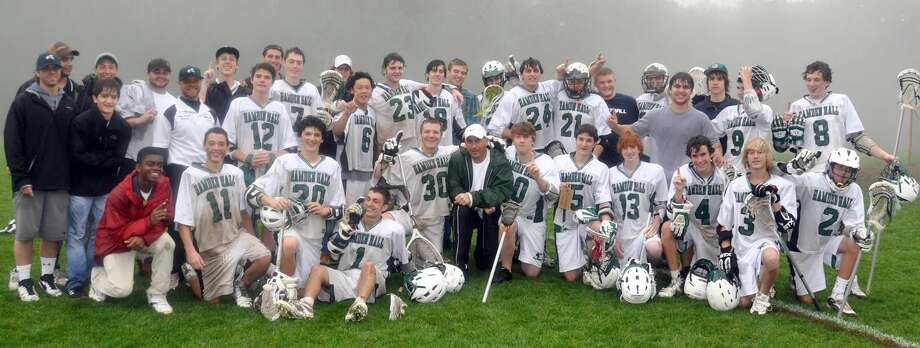 Submitted photo The Hamden Hall boys' lacrosse team celebrates its 5-4 win over rival Hopkins last Monday in New Haven.