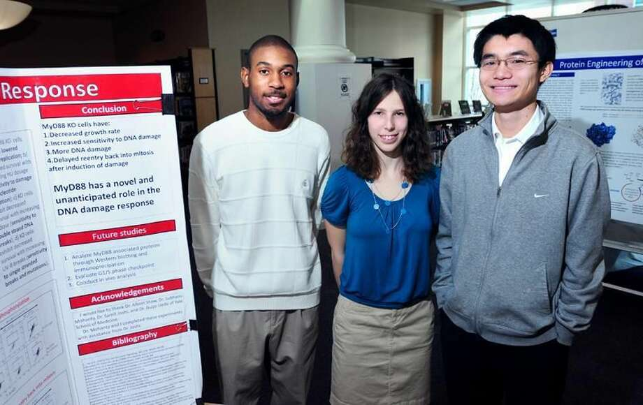 """Photo by Arnold Gold Alaric """"Justin"""" Gee, Bonnie Hawkins and Yiyuan """"David"""" Hu are recognized for their recent accomplishments in science contests at Hamden High School."""