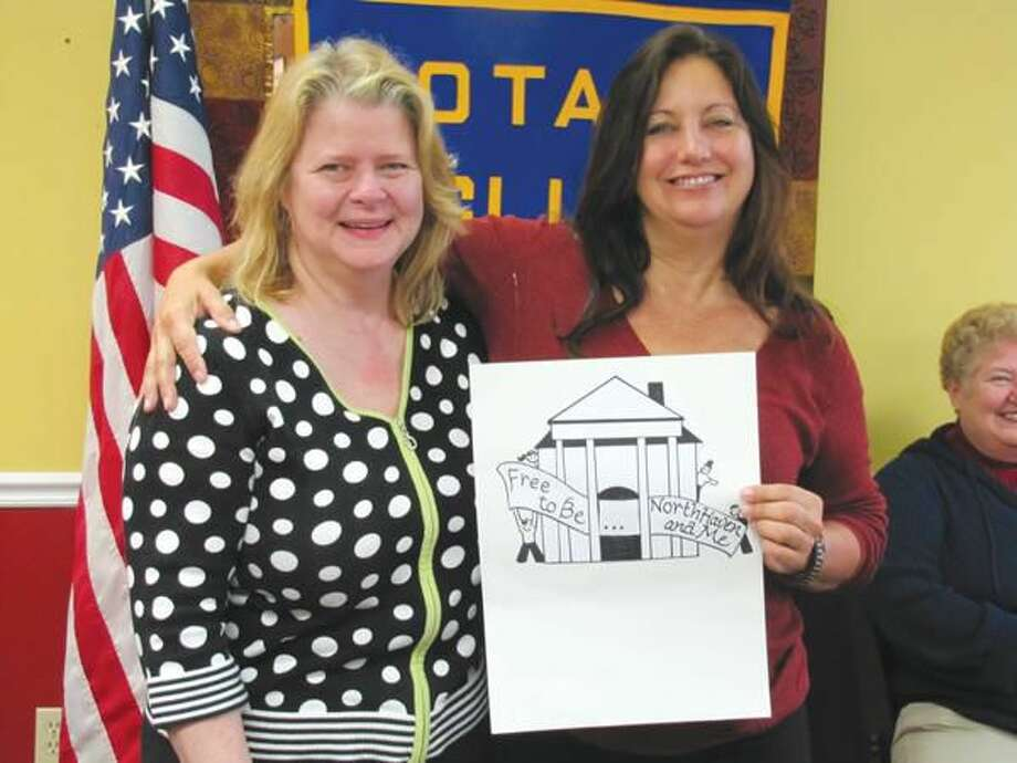 Submitted photo courtesy of David Marchesseault, Rotary Secretary Committee Chair Theresa Viele (R) thanks fellow Rotarian Susan Pace for her poster design for the club's June 4 celebration of North Haven's 225th Anniversary.