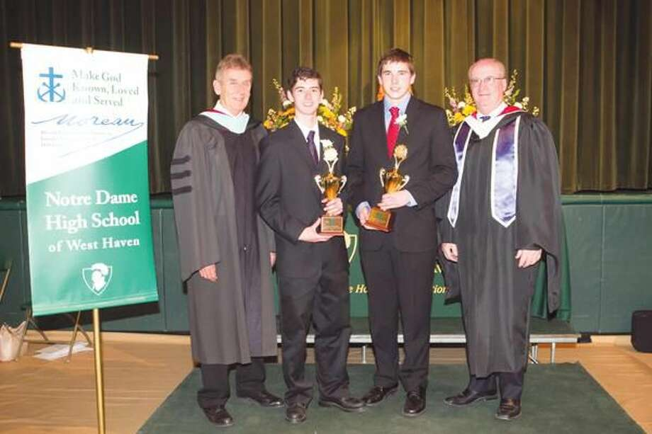 Submitted Photo Notre Dame President Brother James Branigan, valedictorian Matthew Hillier, salutatorian Benjamin Donarum, and Principal Patrick Clifford pose for a picture following Honors Night on May 5.