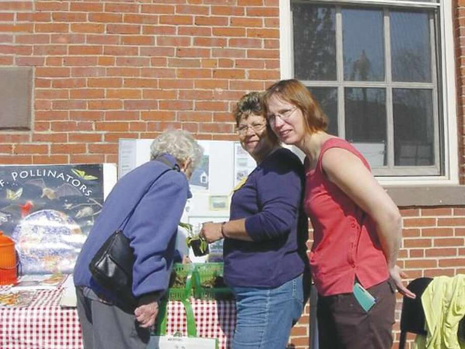 Submitted Photo Wallingford Garden Club Vice President Carole Golitko (center) and her friend Gina Morgenstein (right) at the club's annual plant sale May 7.