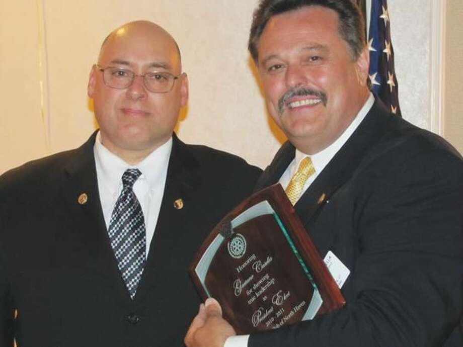 "Photo courtesy of David Marchesseault, Rotary Secretary Rotary President Rick DiNorscia (2010-11) honored Presidet-Elect Guy Casella, right, with a placque that read ""for showing true leadership"" during the president's personal health crises."