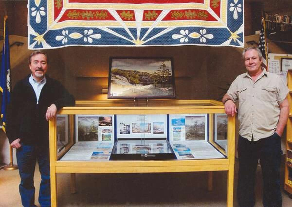 Submitted photo by Gail Donahue Mike Donahue, left, and Roger Donahue, right, are pictured with their display at the Hamden's Miller Memorial Library.