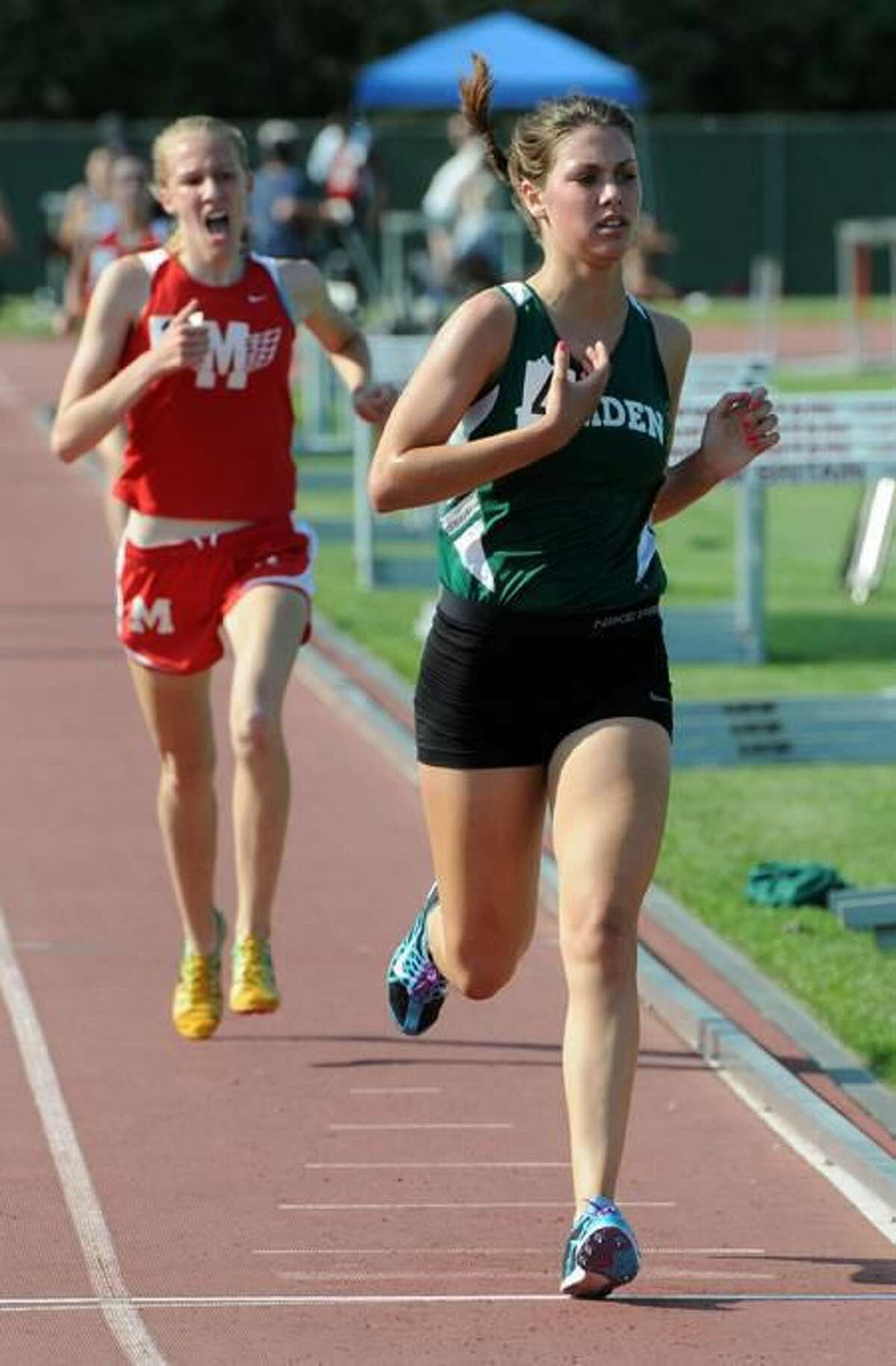 Photo by Mara Lavitt/Register Mara Lieberman finishes third in the 1600 at the Class LL track championships, Willowbrook Park, New Britain.