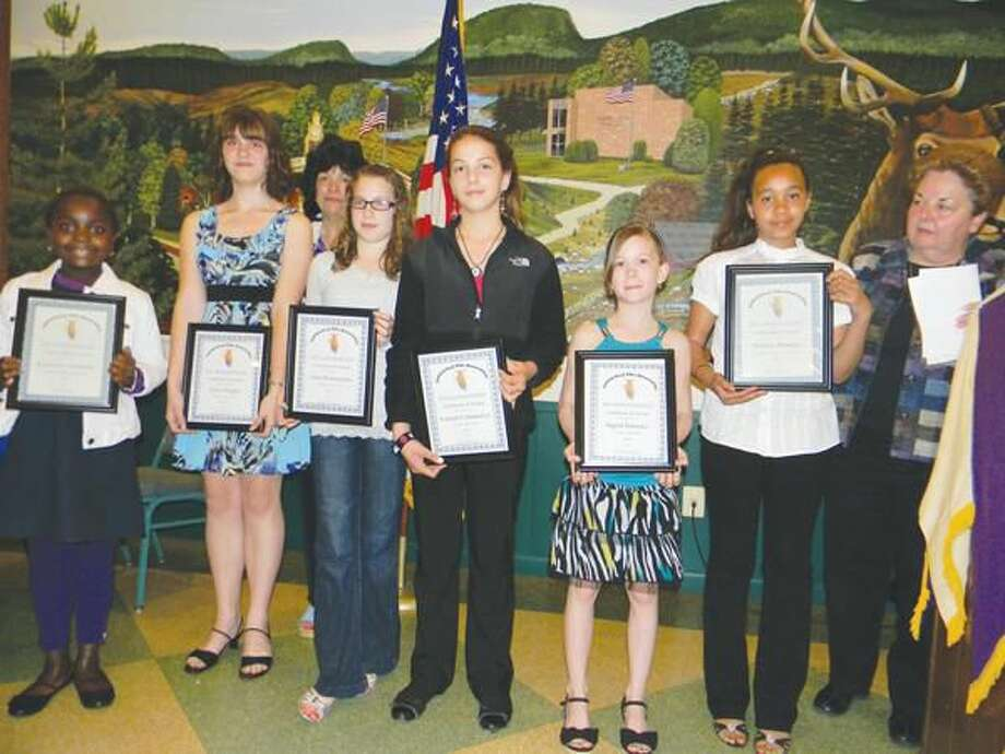 Submitted photo Local winners of the Elks Drug Awareness Poster and Essay Contest and Elks Americanism Essay Contest are shown at the Hamden Elks Youth Banquet in May.