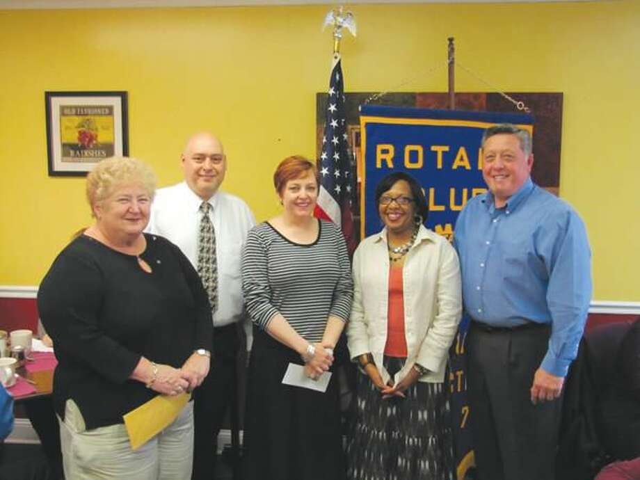 Submitted photo by David Marchesseault, Rotary Secretary Jennifer Occhicone, left center, and Diane Calloway, right center, accepted a North Haven Rotary club check for Abby's All Stars from Past President Nick Casella, right, as Mary Jane Mulligan and President Rick DiNorscia looked on.