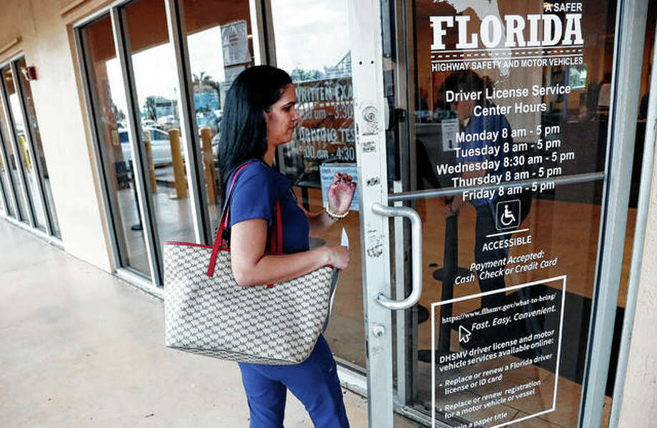 A woman enters a Florida Highway Safety and Motor Vehicles drivers license service center in Hialeah, Florida. The U.S. Census Bureau has asked the 50 states for drivers' license information, months after President Donald Trump ordered the collection of citizenship information. Photo: Wilfredo Lee | Associated Press