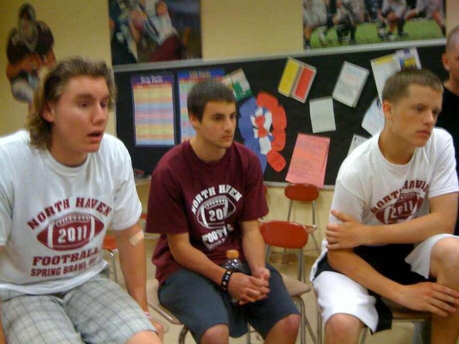 "North Haven High School football players Joe Schwab, Matt Manemeit and Spencer Oakes talk about the ""Spring Brawl."" Photo by Ann DeMatteo/Register"