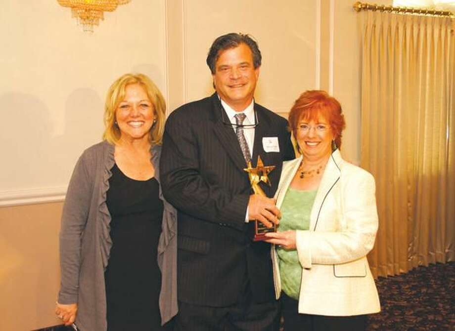 Submitted photo compliments of Macksimum Memories Photography Pictured left to right: Cindy Semrau, VP Quinnipiac Chamber of Commerce; Michael Tiscia, owner of Michael's Trattoria and Shining Star Award recipient; and Robin Wilson, President Quinnipiac Chamber of Commerce.