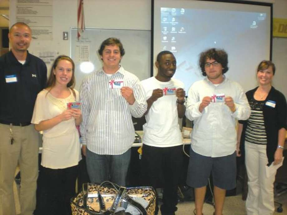 Submitted Photo The team selected as the 2011 DECA Apprentice Challenge was comprised of seniors (from left to right): Rachel Dowe, Thomas Rapini, Damion Sydnor, Zachary Earley, and Hector Del Rio (not pictured). The winning team was awarded Bob's Gift Cards for their efforts. Also, shown in the photo are Chris Bergin, Store Manager (far left) and Allison Sens (far right).