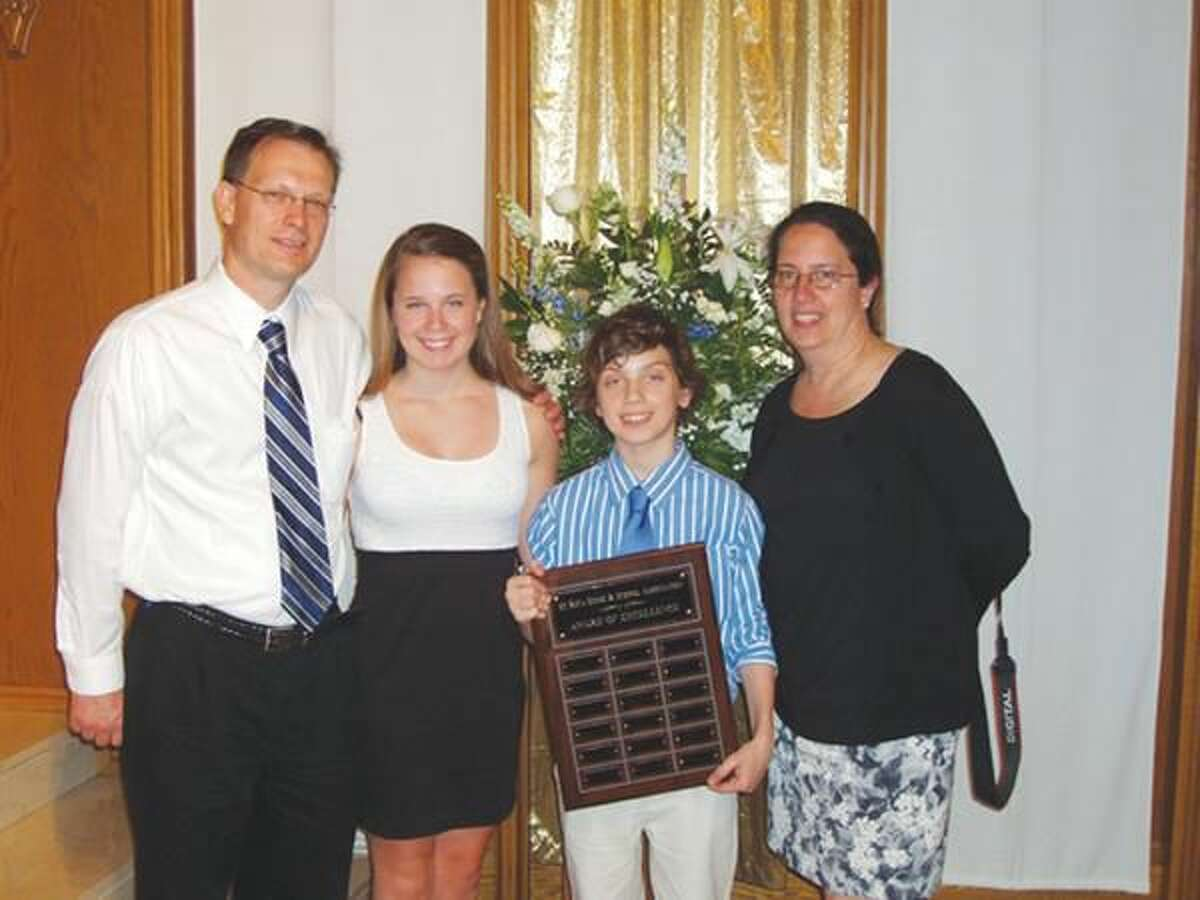 Submitted Photo Pictured with award recipient Andrew Jefferies are parents Colin Jefferies, far left, and Tricia Jefferies, far right, and sister Nora Jefferies.