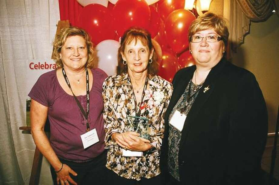 Submitted Photo Left to right, Masonicare Health Center's Jane Tomasselli, Nurse Supervisor; CNA Joan Houle, recipient of an Employee of the Year Award from CANPFA; and Melinda Schoen, Vice President for Nursing Services, at CANPFA's 22nd Annual EXPO held at the Aqua Turf Club.