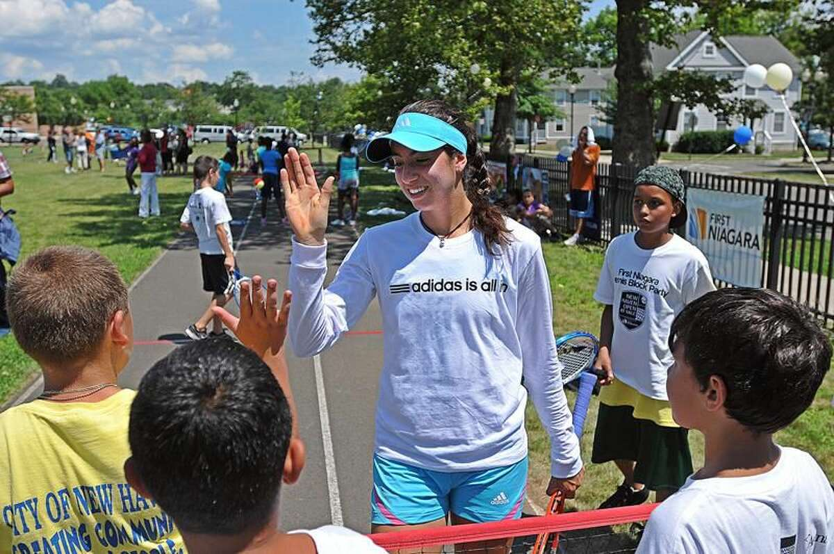 """Photo by Peter Casolino/Register Tennis pro, 19-year-old Christina McHale of Englewood Cliffs, N.J. plays with area kids at the """"First Niagara Block Party"""" 10-and-under tennis clinic."""