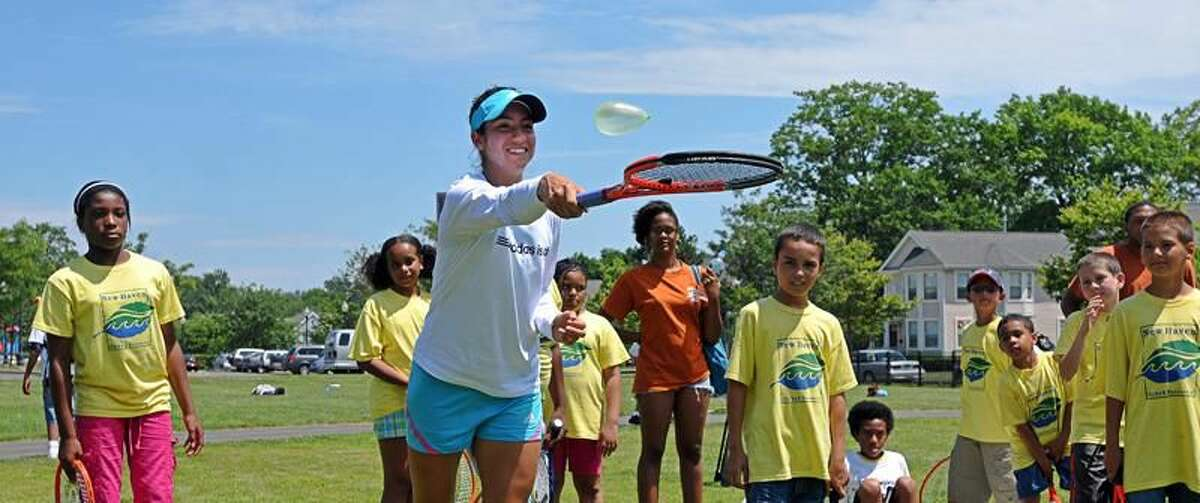 Photo by Peter Casolino/Register Christina McHale catches a water balloon during a game with area kids.