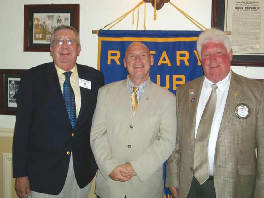 Submitted Photo John Nolan, right, is pictured here with Rick Bassett, center, and outgoing Club President, Rich Miller, left, who recently completed his second term as president as well.