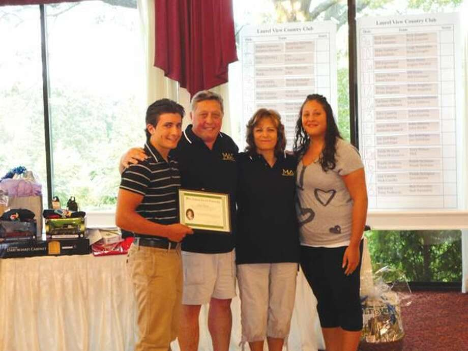Submitted photos courtesy of David Marchesseault, Rotary Secretary Notre Dame H.S. 2011-12 senior, Chris Parisi, receives $1,000 MAC Memorial Scholarship from Nick, Elisa, and Cristina Casella.