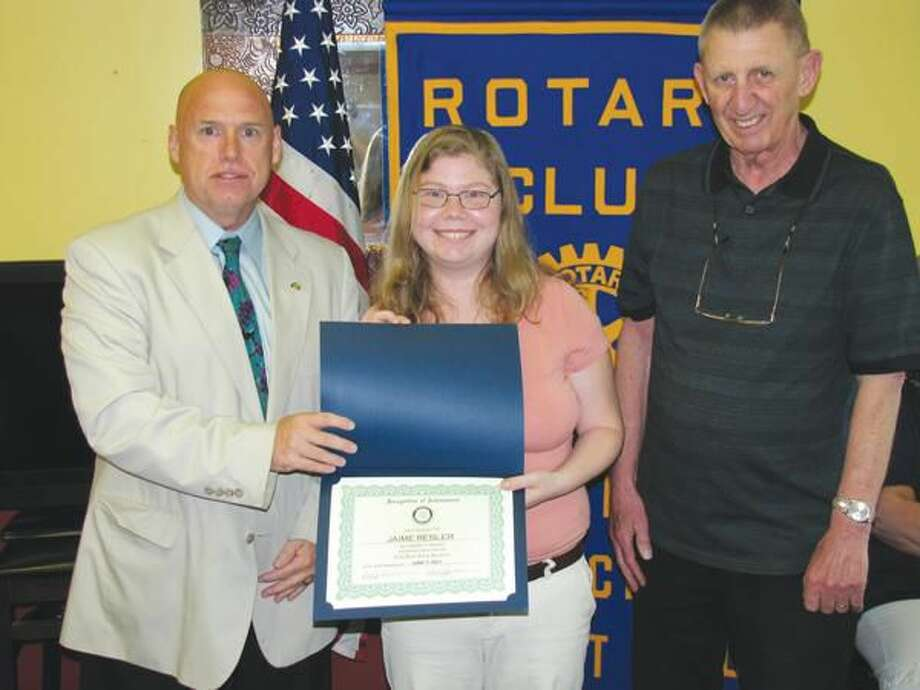 Photo courtesy of David Marchesseault, Rotary Secretary NHR Foundation Chair Rick Bassett, left, and foundation investment manager Hal Ginter congratulate Jamie Resler.