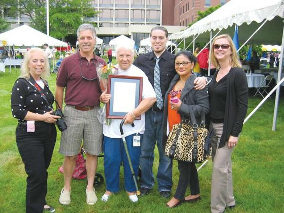 Submiited Photo Volunteer Evelyn Della Rocco, who received the Luke A. Lockwood Award from Masonicare, is surrounded by her family at Grand Masters Day on the Masonicare campus in Wallingford.