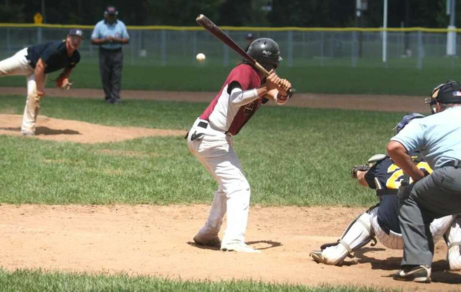 Photo by Russ McCreven East Haven's Mike Anastasio fires a pitch to North Haven's Jonathan Padilla in a recent American Legion baseball game.
