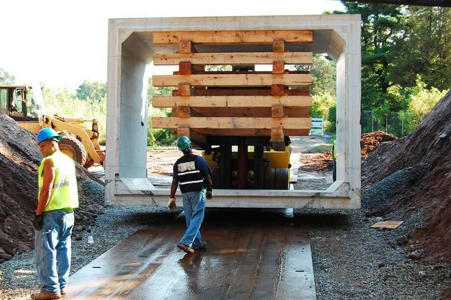 Workers install a box culvert as part of a tunnel underneath Skiff Street in Hamden. Town of Hamden/Contributed photo