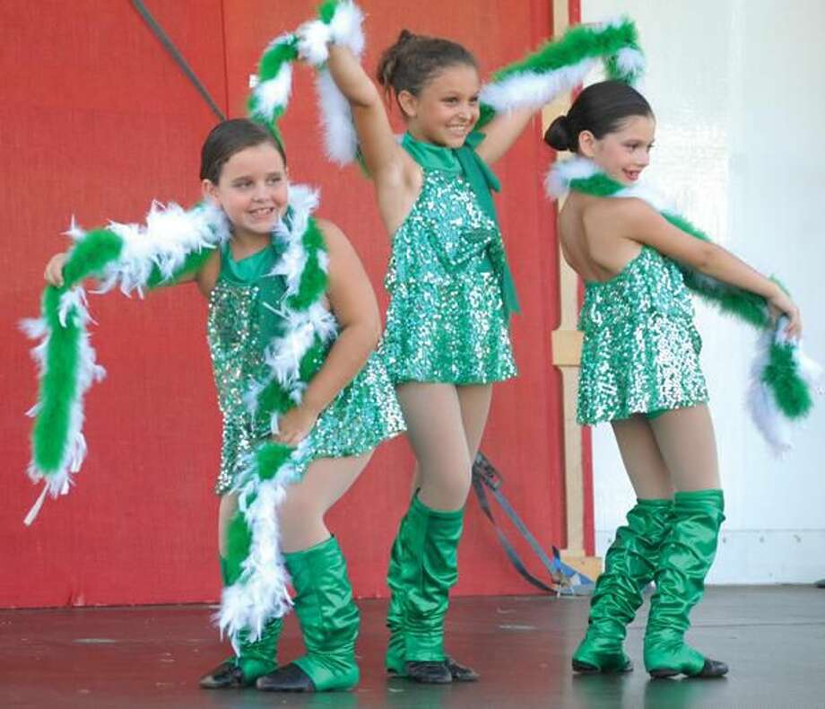 "Photo by Melanie Stengel Brooke Richitelli, Stella Deangelis, and Abby Flonc, all 8, perform a dance to ""Little Shop of Horrors."""