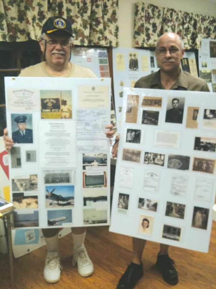 Photo by Ann DeMatteo Ralph Casciello and Glenn Pantaleo show off displays of the history of local veterans of Italian descent. The displays will be show as part of the culture tent at the North Haven Festival of Angels on Friday and Saturday. They are members of the Sons and Daughters of Italy Lodge 2805.