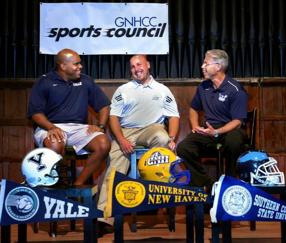 """Yale coach Tom Williams, left, shown at Tuesday's """"Chalk Talk"""" with New Haven coach Pete Rossomando, middle, and Southern Connecticut's Rich Cavanaugh, found out his Bulldogs were ranked third in this year's Ivy League preaseason poll. (Melanie Stengel/Register)"""