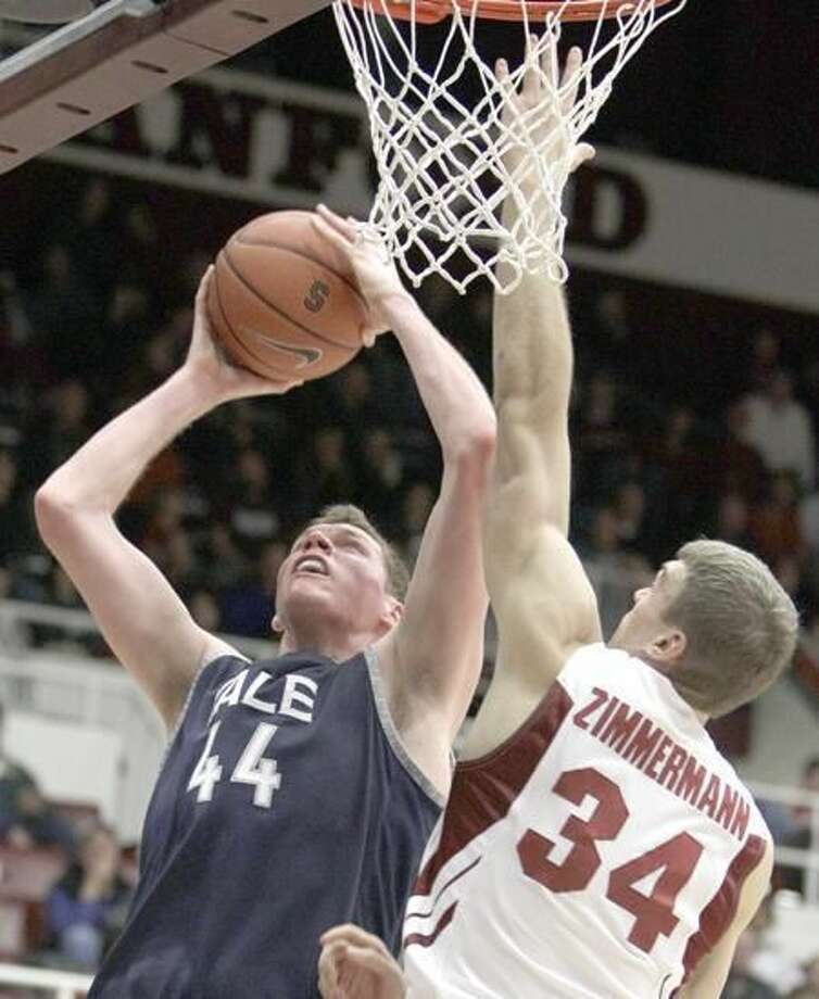 Yale's Greg Mangano (44) goes up for a shot over Stanford's Andrew Zimmerman (34) during the first half of an NCAA college basketball game Tuesday, Dec. 28, 2010, in Stanford, Calif. (AP File Photo/Ben Margot)