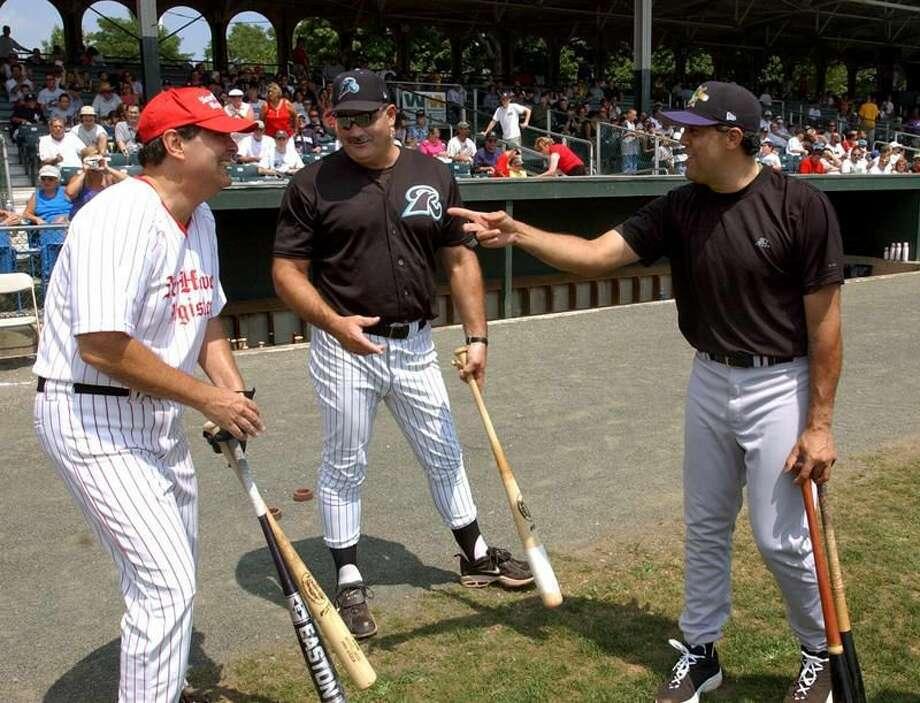 File photo by Mara Lavitt/Register New Haven Register columnist Dave Solomon, left, Ravens batting coach Steve Balboni center, and Norwich Navigator Luis Sojo after the Home Run Derby at Yale Field.