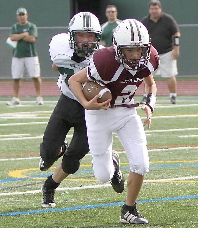 Photo by Gail Tantorski Kyle Melillo runs away from a Guilford defender.
