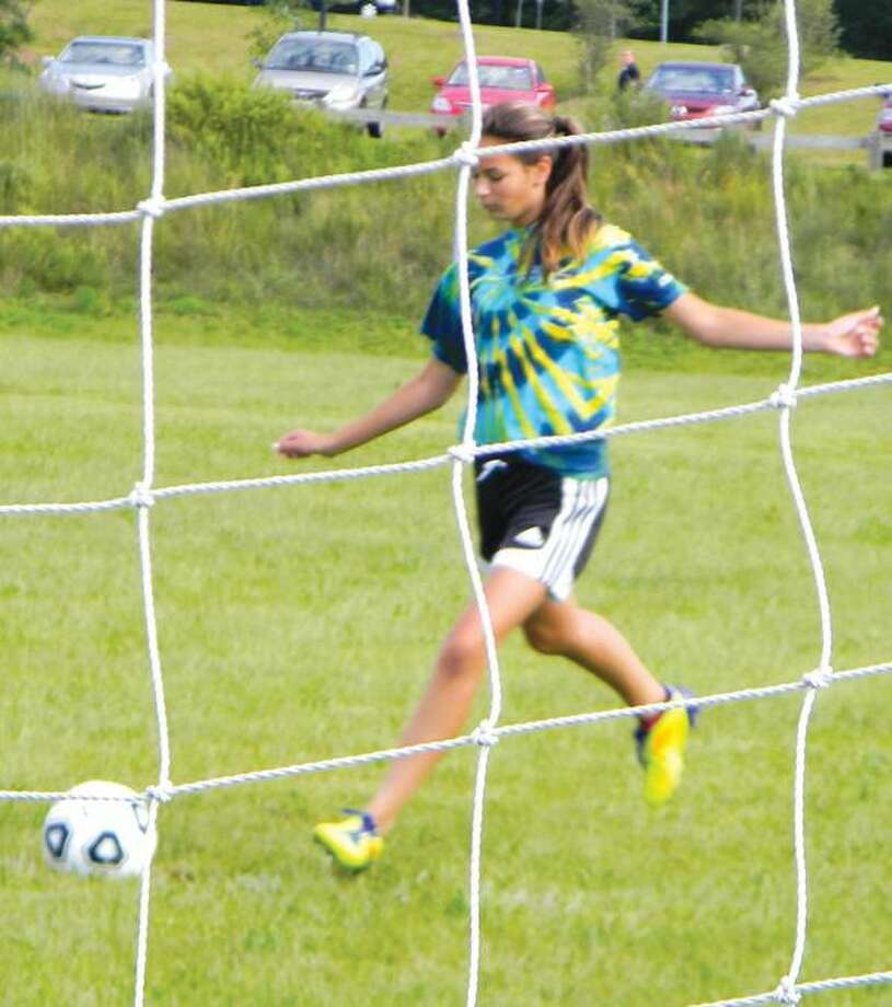 Submitted Photo Niki Pallotte takes a shot on goal at the Hamden Elks Soccer Shoot, Sunday, Sept. 11.