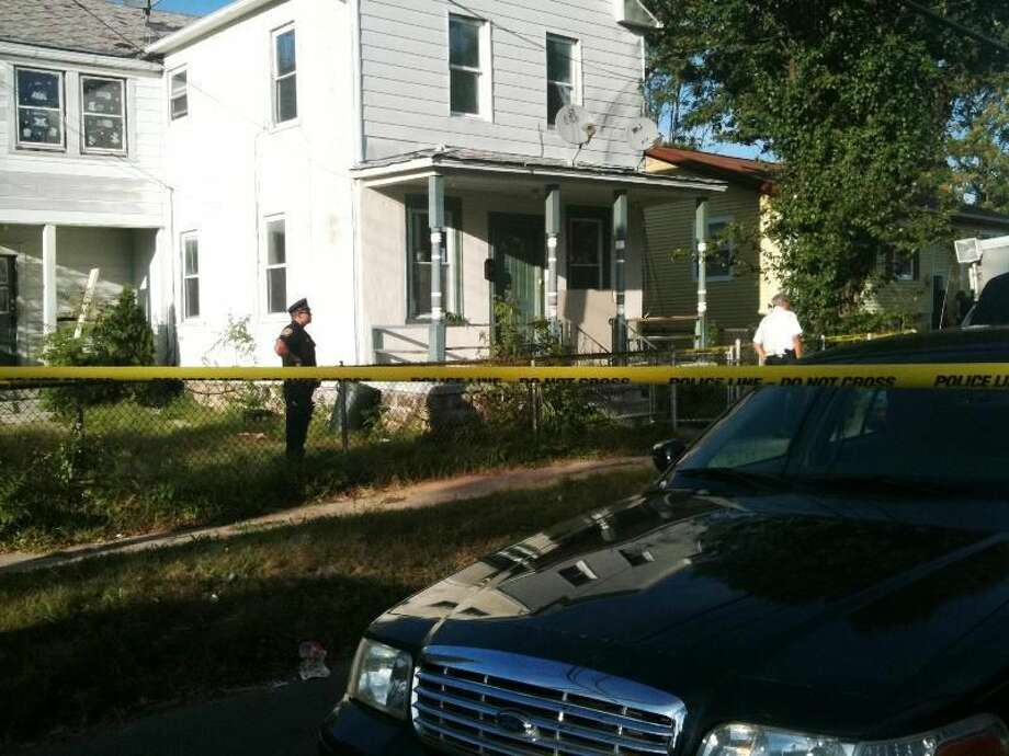 Hamden police at scene where body was found at home on Goodrich Street. Ann DeMatteo/Register.