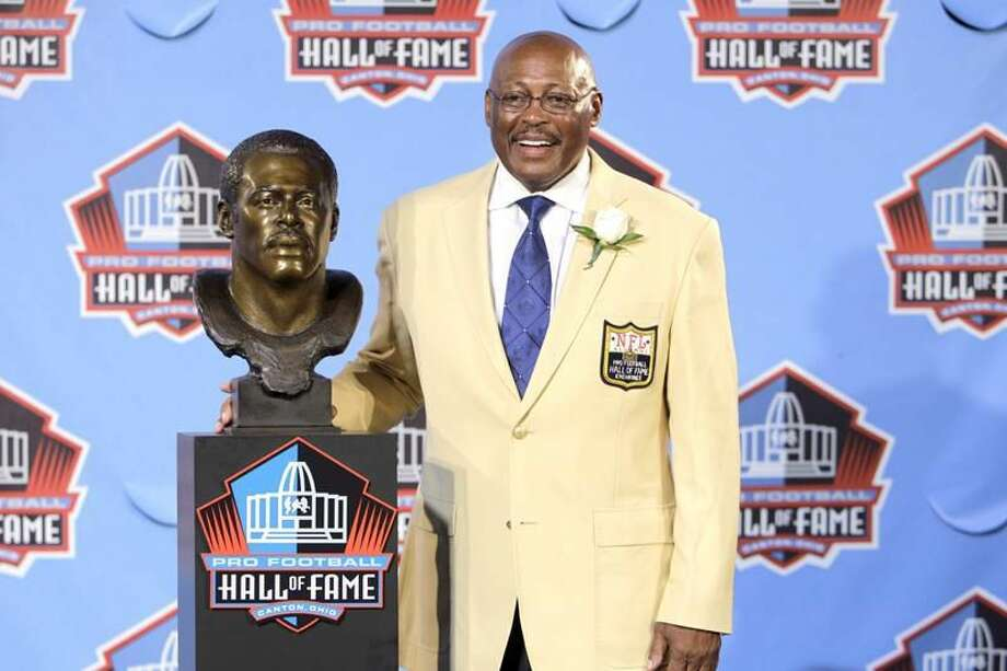 Floyd Little poses with his bust after enshrinement in the Pro Football Hall of Fame in Canton, Ohio Saturday, Aug. 7, 2010. (AP Photo/Mark Duncan)