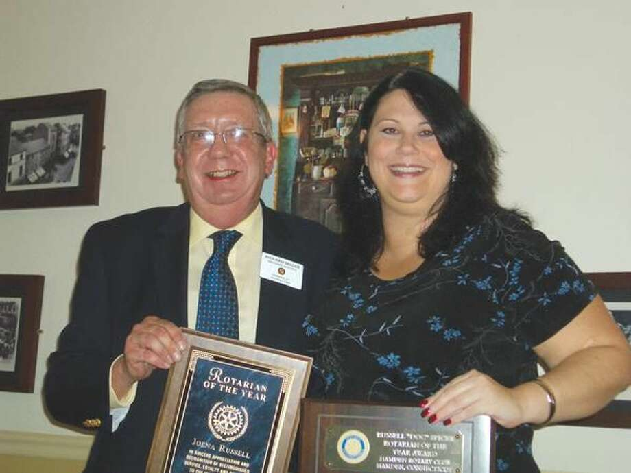 Submitted Photo Rotarian of the Year Joena Russell stands with 2010-2011 Club President Rich Miller.