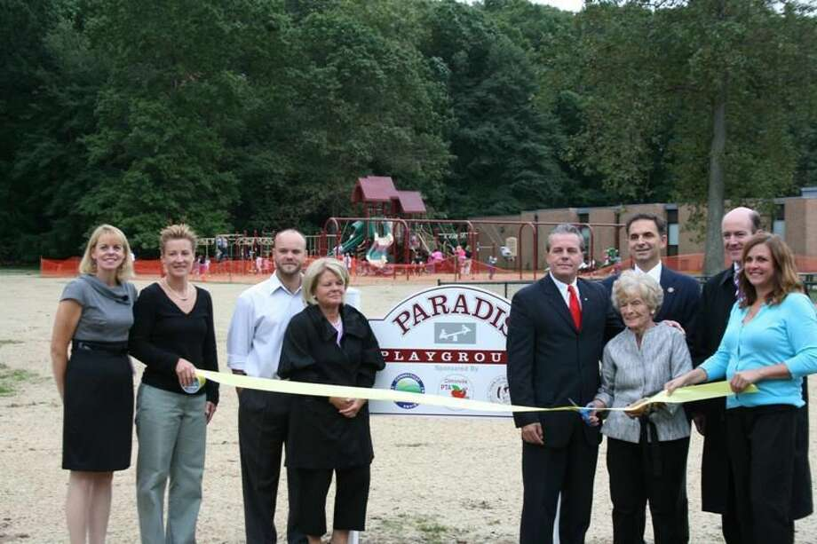 Submitted photo courtesy of Jennifer Crisanti From left, Principal Lauretta Dowling, teacher Kim Doheny, Kiernan Griffin, Beth Griffin, Michael Paradis, Carmela Paradis, Rep. Dave Yaccarino, Selectman Steve Fontana and Kathleen Kessler attend the dedication of the Clintonville Elementary School's Paradis Playground, named to honor the retired North Haven teacher of 59 years.