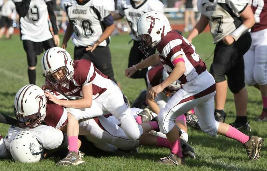 Photo by Gail Tantorski The North Haven seventh-grade team's defense makes a stop in a recent game.