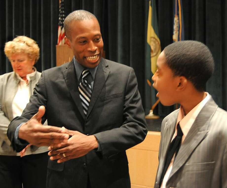 Photo by Melanie Stengel Mayor Scott Jackson-talks with Hamden Middle School seventh-grader Robert Richards after a school meeting in which the mayor announced that Hamden was on the list of the top 100 cities for young people. Superintendent of Schools, Fran Rabinowitz, is back left.