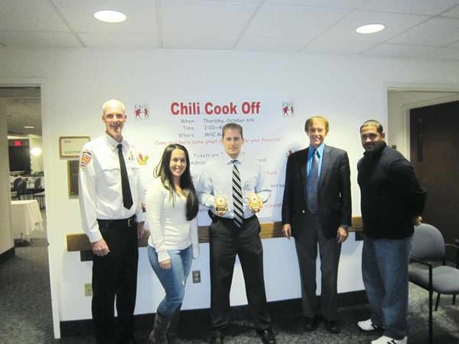 Submitted Photo Pictured left to right, Steve Alsup, Wallingford Deputy Fire Chief; Stephanie O'Connell, reporter for the Meriden Record-Journal; Jesse Camp, chili cook-off winner; Mayor Bill Dickinson, and Efrain Nieves, owner of Tata's Restaurant in Wallingford.