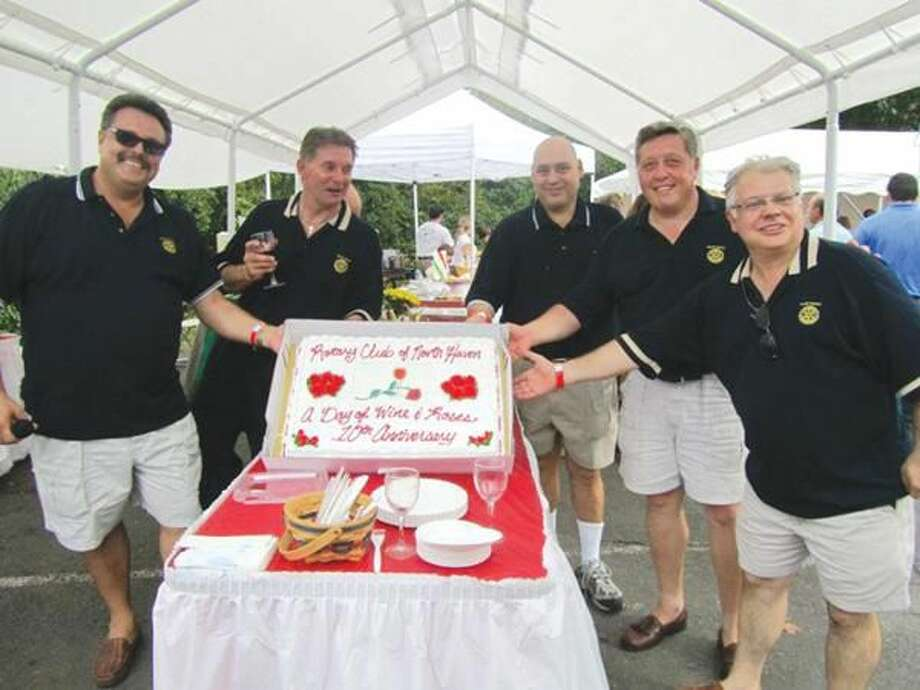 """Submitted photo courtesy of David Marchesseault, Rotary PR Chairman North Haven Rotary President Guy Casella, event chairman Mike Hallahan, and past presidents Rick DiNorscia, Nick Casella and Luigi Nuzzolillo display a special cake at the """"Day of Wine & Roses."""""""